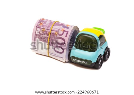 Toy car and five hundred euro banknotes with a rubber band  - stock photo