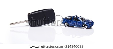 Toy car and key over white background - stock photo