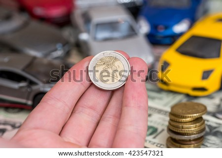 Toy car and money concept