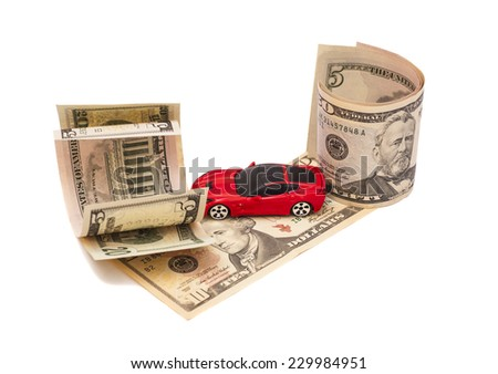 Toy car and money over white