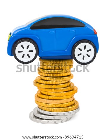 Toy car and stack of coins isolated on white background - stock photo