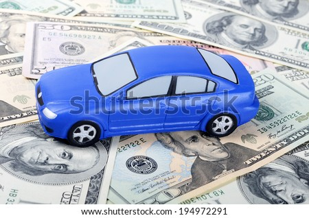 Toy car for dollar banknotes  as background - stock photo