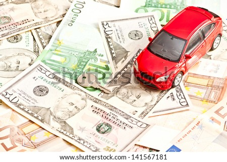 Toy car, key and money over white. Rent, buy or insurance car concept - stock photo