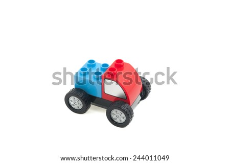 Toy car made from plastic block - stock photo
