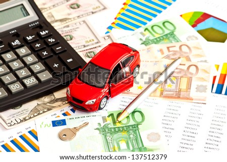 Toy car, money and other business staff  - stock photo
