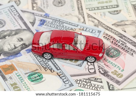 Toy car on money background - stock photo