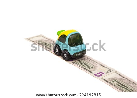 Toy car on money road isolated on white background  - stock photo