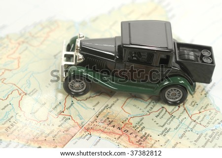 Toy car over a map of south america - stock photo