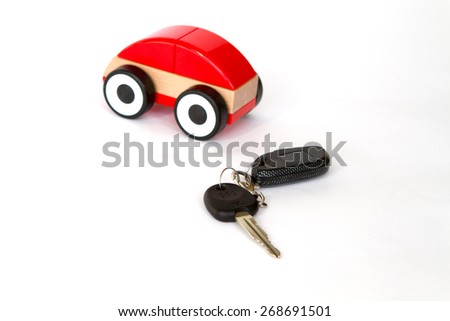 toy car red color on a white background with a remote control and key rent - stock photo