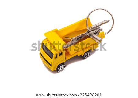 Toy car truck with keys isolated on white background  - stock photo