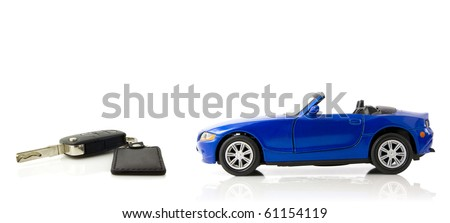 Toy car with a keys on white background with mirror - stock photo
