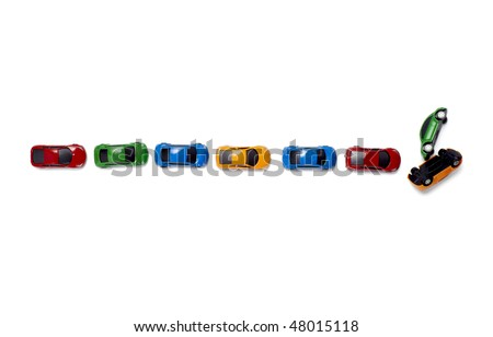 toy cars in a row isolated on white background with clipping path - stock photo