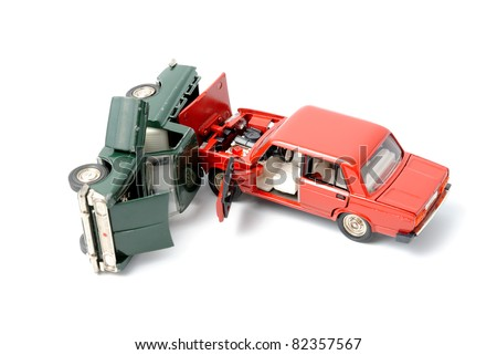 Toy cars in accident on a white background - stock photo
