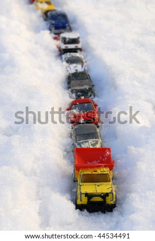 Toy Cars in Snow - stock photo