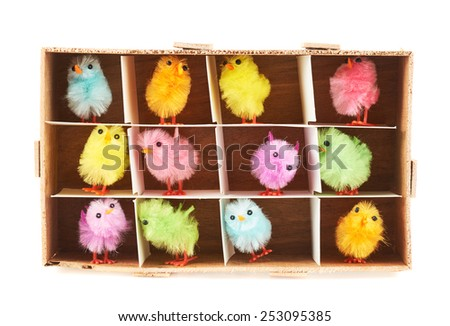 Toy chickens in wooden box isolated over the white background - stock photo