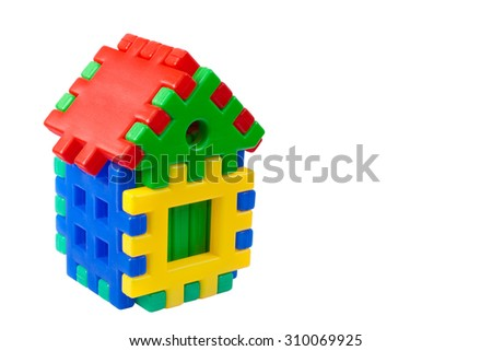 Toy colored house on a white background with space for text - stock photo