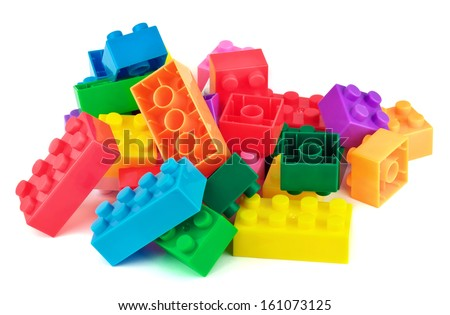 Toy colorful plastic blocks isolated on white background  - stock photo