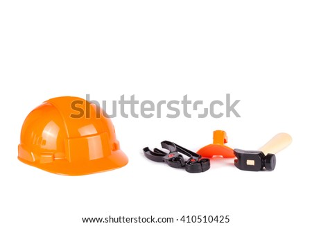 Toy construction helmet and tools over a white background. Children toy tools - stock photo