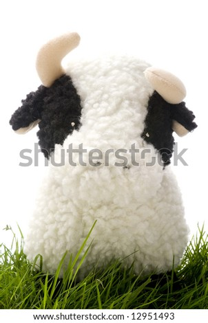 Toy Cow on Grass - stock photo