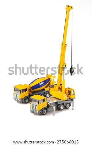 toy crane and concrete mixer truck are isolated on white backgroung - stock photo