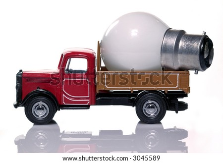 Toy delivery truck with a light bulb in,isolated on white. Concept of delivering ideas. - stock photo