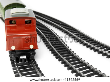Toy Diesel Locomotive and caboose - stock photo