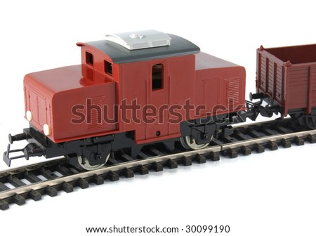 Toy Diesel Locomotive and freight wagon on white background - stock photo