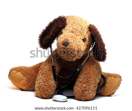 toy dog with a stethoscope on a white background