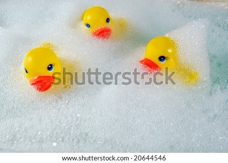 toy ducks in bubble bath - stock photo