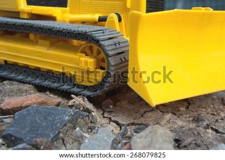 Toy excavator - stock photo