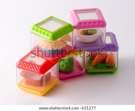 toy food containers, stacked - stock photo