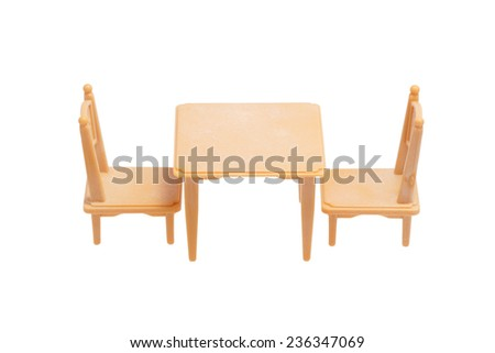 Toy furniture. Table and two chairs. Isolated on white.                              - stock photo