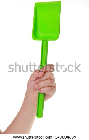 Toy green spade isolated on white background