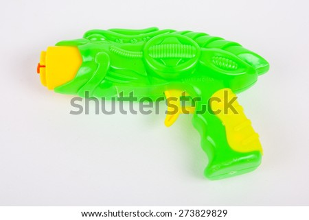 toy gun on white paper background - stock photo