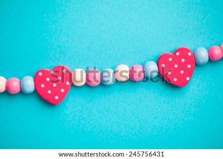 toy heart shapes on blue background - stock photo