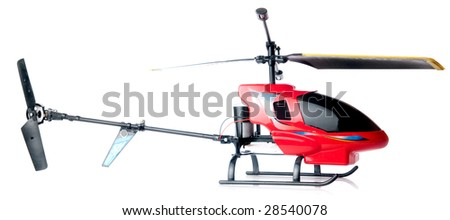 Toy helicopter over white background. Focus on red cockpit. - stock photo