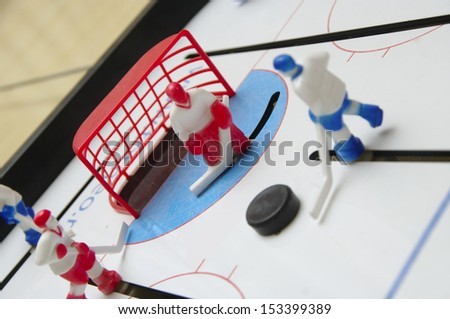 toy hockey, the attack on the gate - stock photo