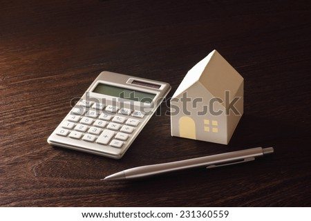 toy house and calculator on the table