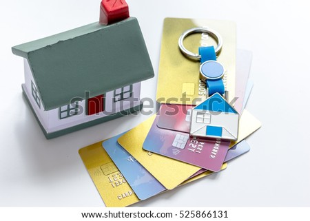 toy house, credit cards - concept mortgage on white background
