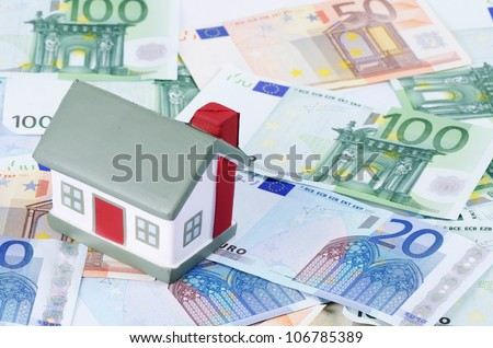 toy house for euro banknotes as background - stock photo