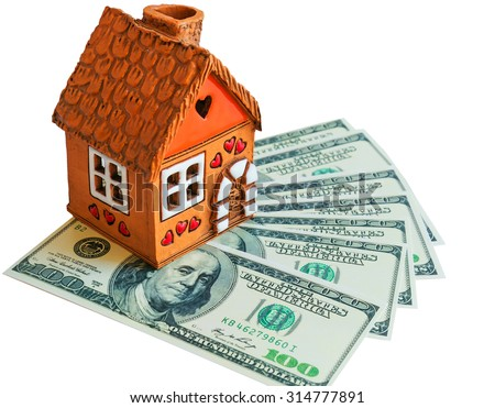 Toy house is on the dollars - stock photo