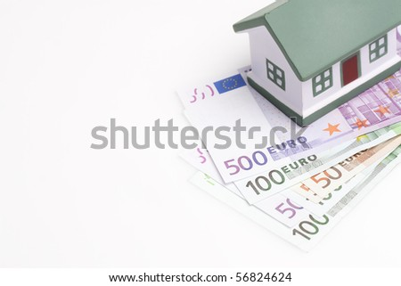 toy house on top of european banknotes - stock photo