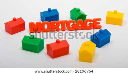 Toy houses surrounding the word Mortgage