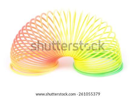 toy isolated on white. Rainbow spring toy. - stock photo