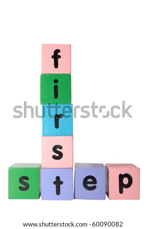 toy letter that spell first step against a white background with clipping path - stock photo