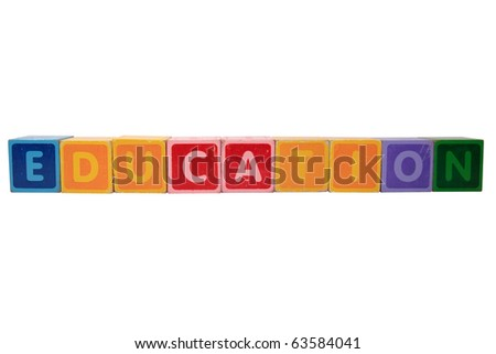 toy letters that spell education against a white background with clipping path - stock photo