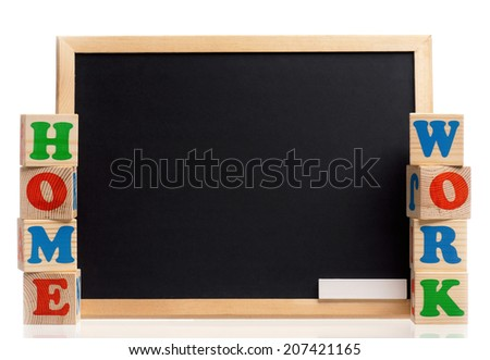Toy letters that spell homework and blackboard over white background - stock photo