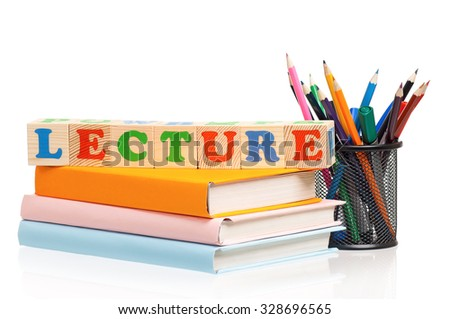 Toy letters that spell lecture and books over white background - stock photo