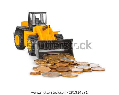 Toy loader and money coins isolated on white background - stock photo