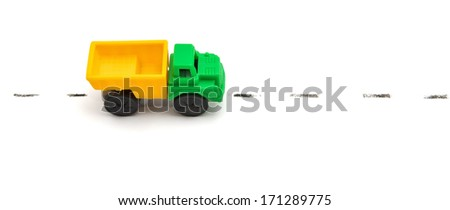 Toy lorry on road. Isolated object. - stock photo